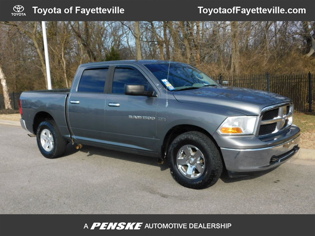 Pre-Owned 2011 Ram 1500 4WD Crew Cab 140.5